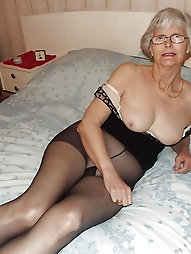 Gorgeous Grey haired glasses wearing granny