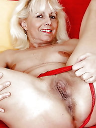 Mature MILF is touching herself