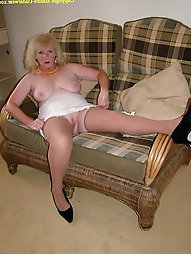 Shaved granny upskirt and spreading in stockings