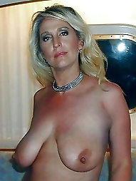 Mature dame is playing alone