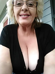 Chubby mature prostitute is taking off her underwear for cash