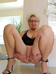 Tattooed mature mademoiselle is showing off her knocker