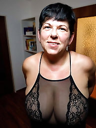 Feisty mature woman is touching herself