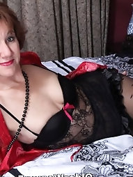 56 year old grandmother Penny toying in ebony stockings
