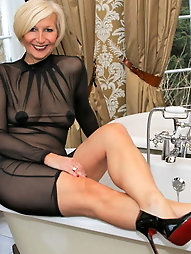 Shapely old MILF is playing herself