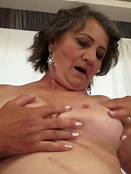 Older lass is covered with semen